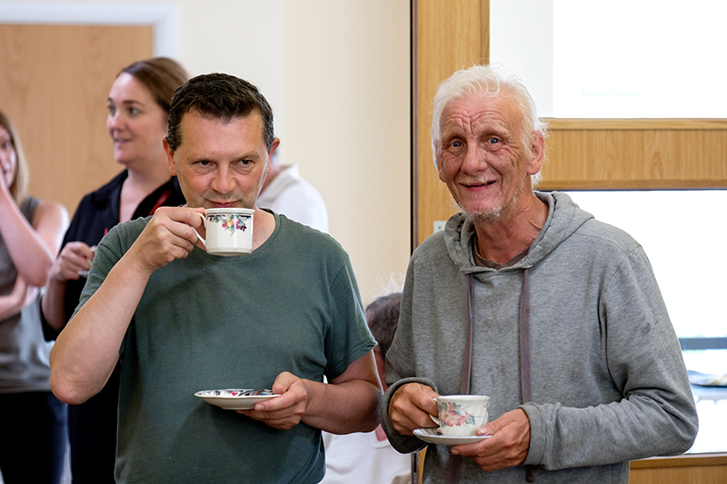 Two men having a cuppa